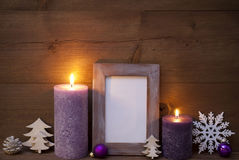 Purple Christmas Decoration With Candles Picture Frame,Snowflake Royalty Free Stock Photography