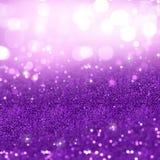 Purple Christmas glitter background. Christmas background of purple glitter Stock Images