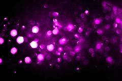 The purple Christmas lights are out of focus. stock images