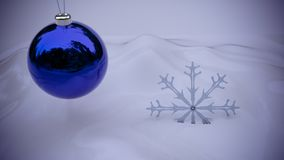 Purple christmas ornament with snowflake on white snow backgroun. Purple christmas ornament with snowflake on white snow background Royalty Free Stock Photography