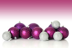 Purple Christmas ornaments. Studio shot stock photography