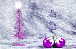 Purple Christmas ornaments with silver background Stock Images
