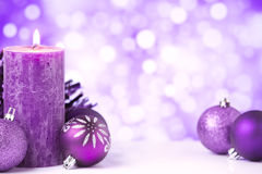 Purple Christmas scene with baubles and candles Stock Photography
