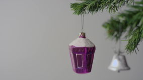 Purple Christmas toy and silver bell on the Christmas tree branch stock video footage