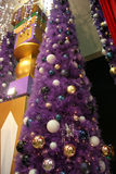 A Purple Christmas Tree!. A gigantic purple christmas tree meticulously decorated with blue, white, silver and gold balls Stock Image