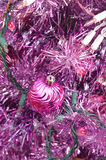 Purple Christmas tree with pink lights and ball ornament Royalty Free Stock Image