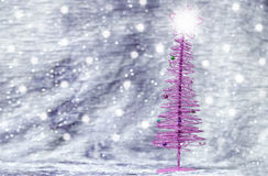 Purple Christmas tree with silver background Royalty Free Stock Photo