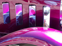 Purple and Chrome. Purple candy coated and chrome antique automobile fender and hood stock photography