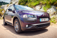 Purple Citroen C4 Cactus on the mountain road Royalty Free Stock Photography