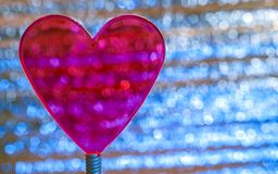Purple Clear Heart On Coil Spring. Metallic foil background with angled Silver shiny stripes, blue highlights. Valentines Day,. Christmas, New Year Banner stock photos