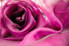 Purple cloth folded in the shape of a rose Stock Photography