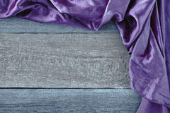 The purple cloth on a wooden board Stock Photography