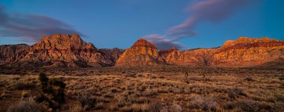 Watchers: Red Rock Canyon Sunrise. Purple clouds float over Red Rock Canyon National Park as sunrise shows the red color of the rocks, Red Rocks Canyon National royalty free stock photography