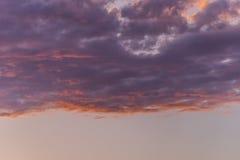 Purple clouds. On sunset sky background Stock Photo