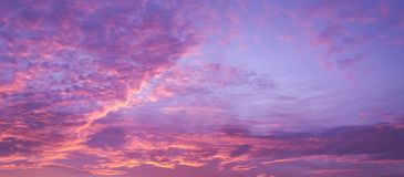 Purple sky. Purple cloudy sky in sunset royalty free stock photography