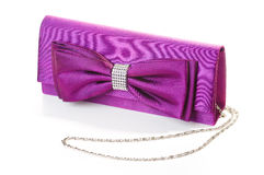 A purple clutch with bow. And diamonds Royalty Free Stock Photo