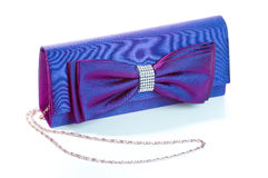 A purple clutch with bow. And diamonds Royalty Free Stock Image