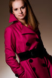 Purple coat. Young fashionable woman wearing purple coat Royalty Free Stock Photos