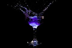 Purple coctail splash Royalty Free Stock Photography