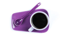 Purple coffee cup with saucer and spoon isolated on white background Stock Photo