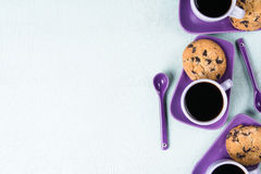 Purple coffee cup with saucer and spoon on light blue background Royalty Free Stock Photography