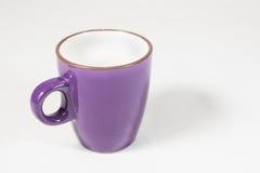 Purple Coffee mug. A purple coffe mug on white background royalty free stock image