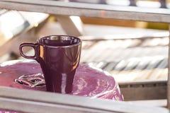 Purple coffee mug on table Stock Image