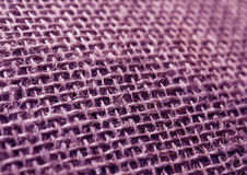 Purple color hessian cloth sack texture with blur effect. Stock Images