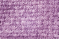 Purple color knitted pattern. Abstract background and texture Stock Images