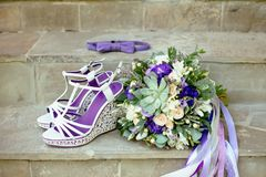 Purple color wedding  accessories with baw tie stock photo