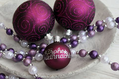 Purple-colored Christmas balls Stock Image