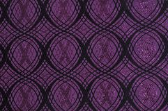 Purple colored patterned fabric texture. Details of the texture and weaving of purple fabric royalty free stock photography