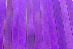Purple colored popsicle sticks background. This is a photograph of Purple colored popsicle sticks background stock photo