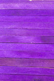 Purple colored popsicle sticks background. This is a photograph of Purple colored popsicle sticks background royalty free stock image