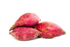 Purple Colored Sweet Potatoes on White background Stock Images