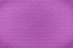 Purple colored yoga mat texture.dng Royalty Free Stock Images