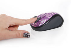 Purple computer mouse and female hand Stock Images