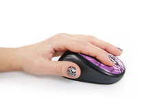 Purple computer mouse in female hand Royalty Free Stock Photos