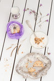 Purple Cookie Gift with Creamy Yogurt and Dried Flowers. White Wooden Table Background Royalty Free Stock Photo