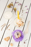 Purple Cookie Gift with Creamy Yogurt and Dried Flowers. White Wooden Table Background Stock Photos
