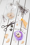 Purple Cookie Gift with Dried Lavender and Black Berries. White Wooden Table Background Royalty Free Stock Photography