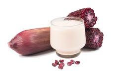 Purple corn cob and corn juice (corn milk). On white background Stock Photography