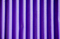 Purple corrugated background. Detail of purple corrugated background Stock Image