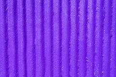 Purple corrugated metal background and texture surface Stock Image