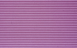 Purple corrugated paper background. Stock Photography