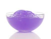 Purple cosmetic cream Stock Photos