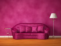 Purple couch with table and standard lamp Stock Photo