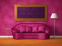 Purple couch with table, standard lamp and frame Royalty Free Stock Photography