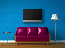 Purple couch, table  and standard lamp with LCD TV Stock Photo