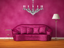 Purple Couch With Table, Lamp And Chandelier Royalty Free Stock Photo